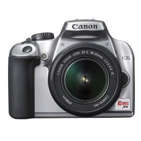 Canon Rebel XS 10.1MP Digital SLR Camera with EF-S 18-55mm f/3.5-5.6 IS Lens (Silver)