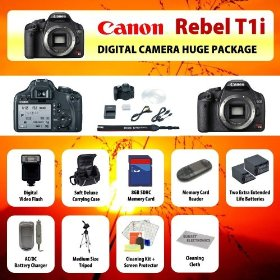 Canon EOS Rebel T1i (500D) Digital SLR Camera Body + 2 Extended Life Batteries + Battery Charger + 16 GB Memory Card + Card Reader + Tripod + Carrying Case + Starter Kit + Digital Flash and more!!